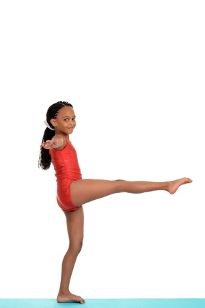 Young girl doing gymnastics balance move Stock Photo - 15282728