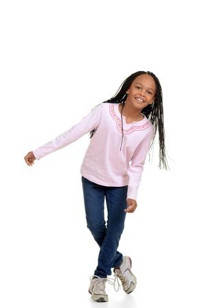 dancing girl: Happy young girl child dancing