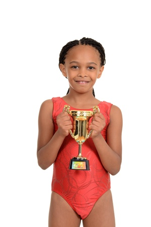 leotard: South African child with gymnastics trophy Stock Photo