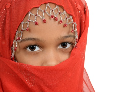 cultural clothing: Young african girl wearing a red scarf Stock Photo