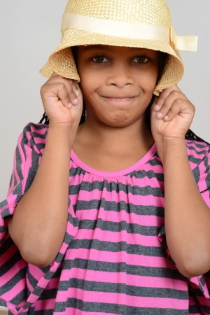 cornrows: Young black child silly with hat Stock Photo