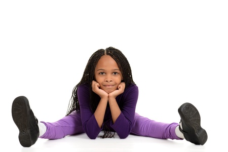 shoe model: Smiling young black girl leaning on elbows
