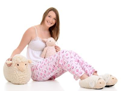 sleepwear: Teenager in pajamas with toy sheep