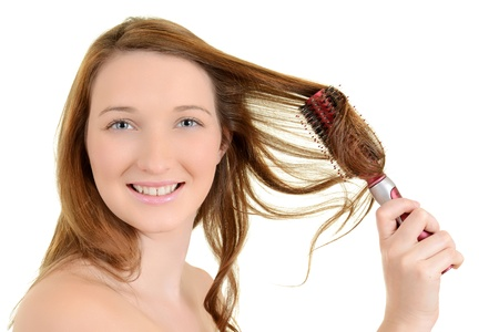 messy hair: Young teen girl curling her hair