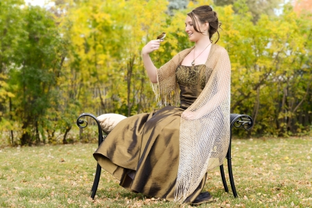 goldfinch: Teen girl in garden with goldfinch bird on finger Stock Photo
