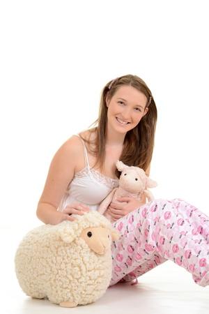 sleep: Young girl in pajamas Stock Photo