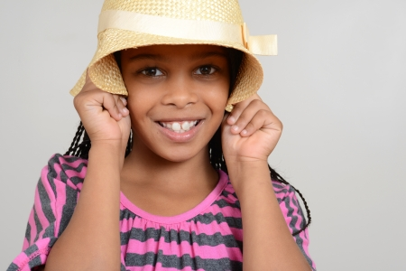 cornrows: African Girl being silly with hat Stock Photo