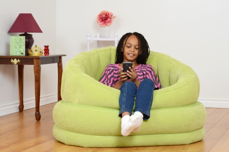 cornrows: Child watching movie on cell phone