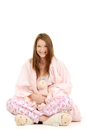 Girl wrapped in pink blanket with toy lamb Stock Photo