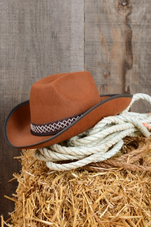 western wear: Closeup cowboy hat and ropes Stock Photo