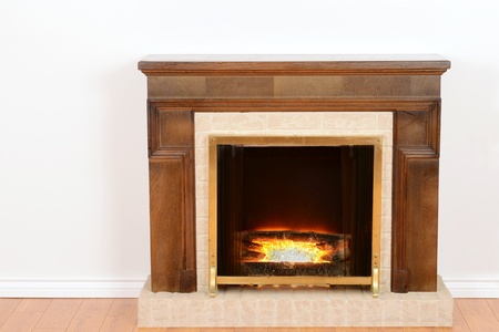 wooden insert: fireplace with fake fire Stock Photo