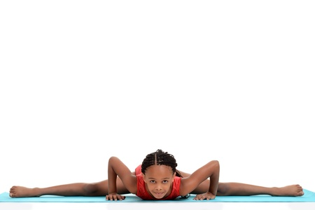 young girl doing gymnastics front split photo