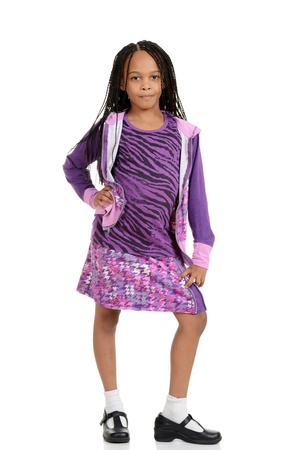 cornrows: Young child posing in purple outfit Stock Photo