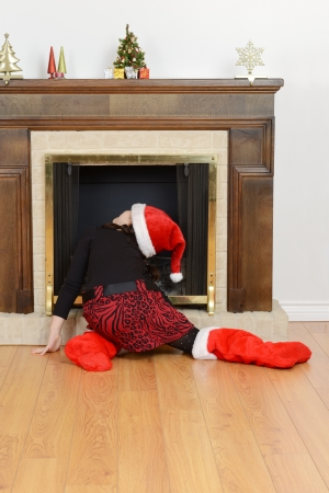 child looking up fireplace for santa Imagens