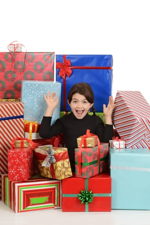 Excited little girl with christmas presents photo