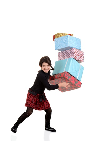 Young girl dropping pile of christmas gifts photo