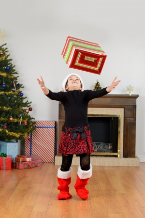 Child catching christmas present photo
