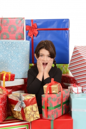 Child surprised with lots of christmas gifts photo