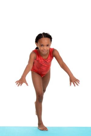 cornrows: child ready to do gymnastics move Stock Photo