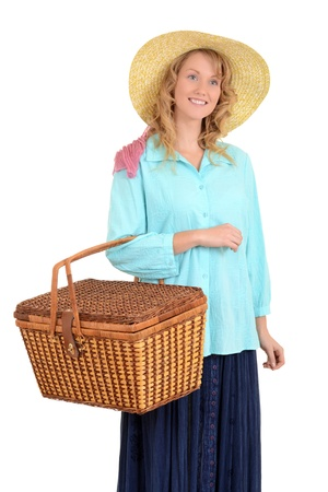 top hate: blond woman carrying picnic basket