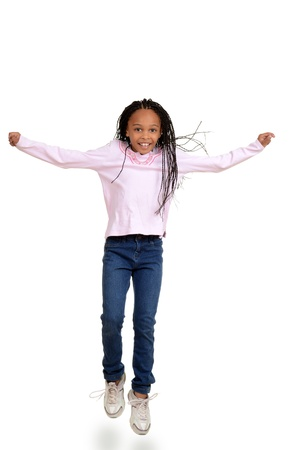 African child jumping in the air photo