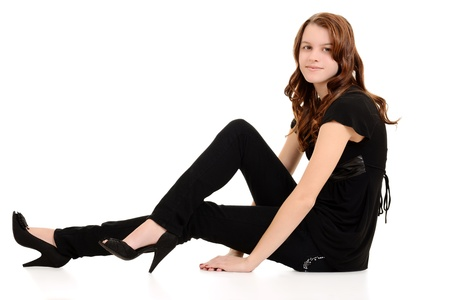Teen girl in black sitting photo