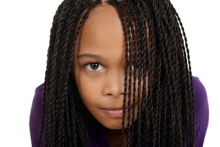 young black child with braids over face photo