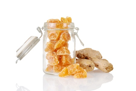 fresh ginger: candied ginger in a jar with root
