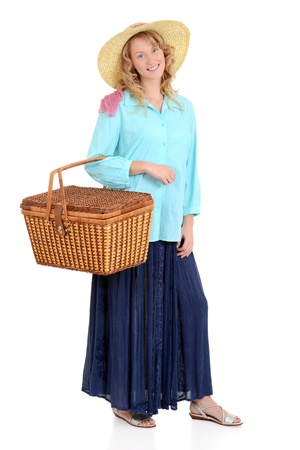 Country woman with picnic basket Reklamní fotografie - 17505875
