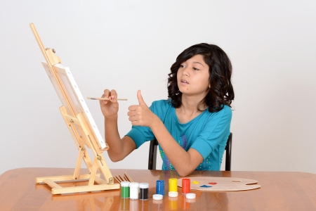 Young child working on painting photo