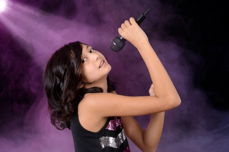 vocalist: Young girl child singing on stage Stock Photo
