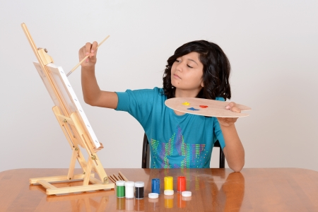 Young child painting photo