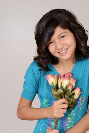 grinning: cute young girl with roses