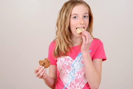 junk: Child eating junk food Stock Photo