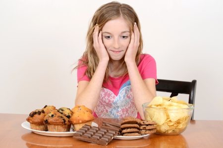 junk: Child with huge pile of junk food