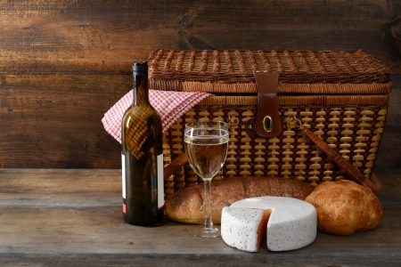 vintage picnic basket with wine photo