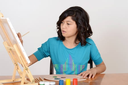 art activity: Young girl painting
