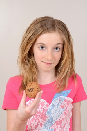Child holding chocolate chip cookie photo