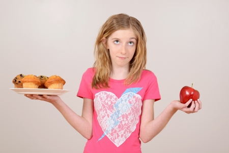 deciding: female child healthy eating concept Stock Photo