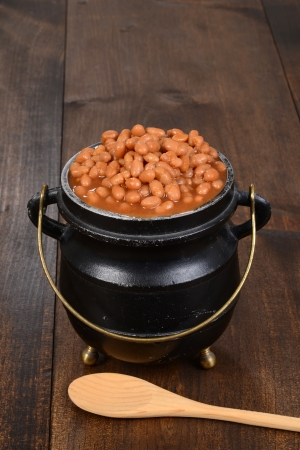 baked beans in pot with spoon