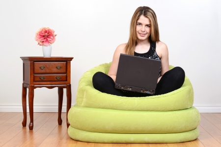 female teen with laptop computer photo