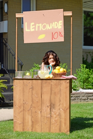 bored girl at lemonade stand photo