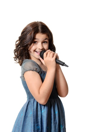 child singing: happy child singing with microphone