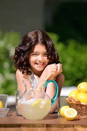 pitcher: happy girl at lemonade stand