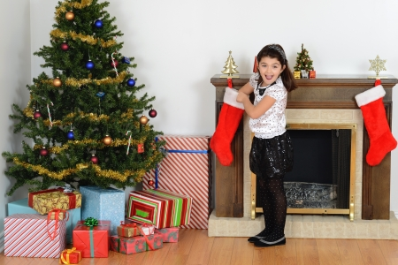 christmas sock: surprised little girl with christmas stocking