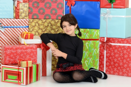 young child leaning on christmas presents photo