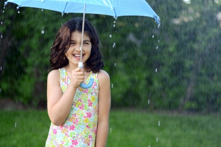 little girl in the rain Stock Photo - 20747365