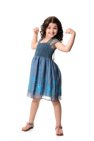 little girl doing muscle pose photo