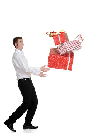 teen boy dropping christmas presents photo