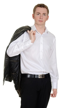 working belt: teen boy with leather jacket over shoulder Stock Photo